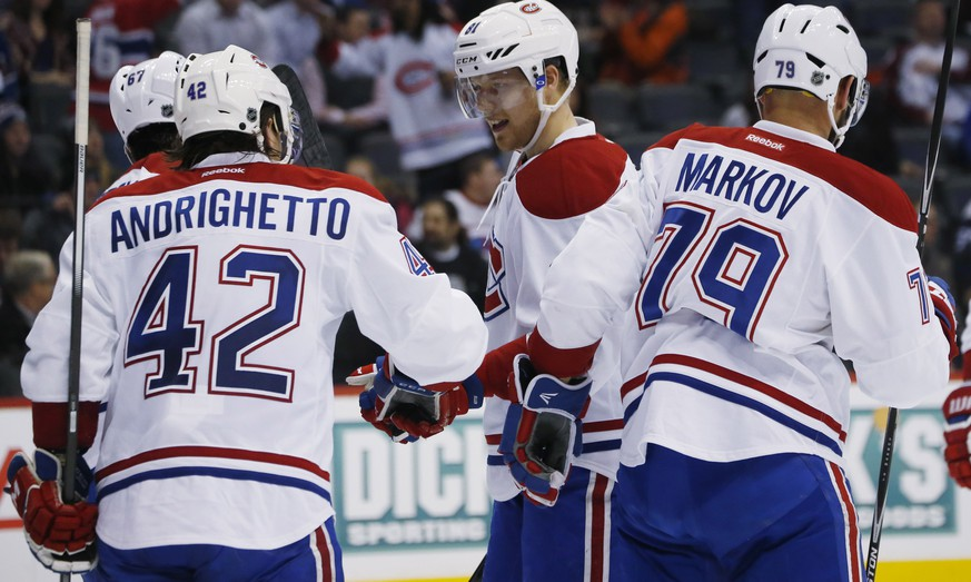 Montreal Canadiens center Lars Eller, third from left, of Denmark, celebrates scoring a goal with, from left, left wing Max Pacioretty, right wing Sven Andrighetto, of Switzerland, and defenseman Andrei Markov, of Russia, against the Colorado Avalanche in the second period of an NHL hockey game Wednesday, Feb. 17, 2016, in Denver. (AP Photo/David Zalubowski)