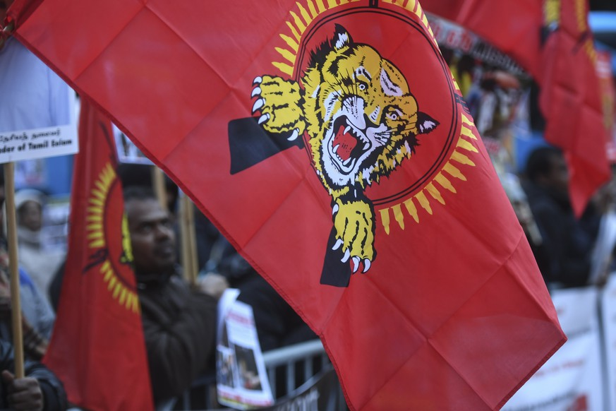 epa06425248 Supporters of the Liberation Tigers of Tamil Eelam protest during the first day of a process against 13 presumably accused sympathizers of the Tamil Tigers on the Piazza della Foca in Bellinzona, Switzerland, 08 January 2018. The process against the sympathizers is assumed to run until March 2018.  EPA/ALESSANDRO CRINARI