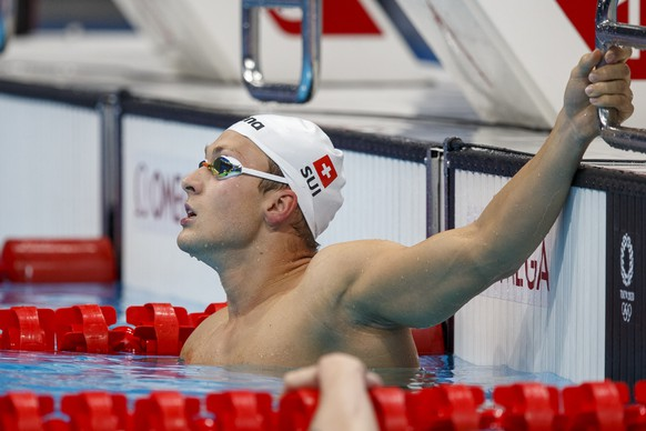 epa09364803 Antonio Djakovic of Switzerland reacts after competing in the men's 200m Freestyle Heats during the Swimming events of the Tokyo 2020 Olympic Games at the Tokyo Aquatics Centre in Tokyo, Japan, 25 July 2021.  EPA/Patrick B. Kraemer