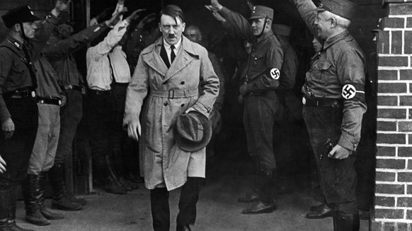 FILE - In this Dec. 5, 1931 file photo, Adolf Hitler, leader of the National Socialists, is saluted as he leaves the party's Munich headquarters. The book,