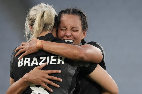 New Zealand's Tyla Nathan-Wong, right, hugs her teammate Kelly Brazier as they celebrate winning their women's rugby gold medal match against France at the 2020 Summer Olympics, Saturday, July 31, 2021 in Tokyo, Japan. (AP Photo/Shuji Kajiyama)