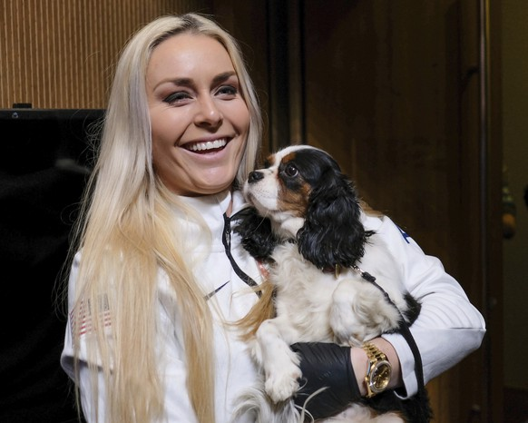 United States alpine skier Lindsey Vonn holds her dog Lucy after a press conference at the 2018 Winter Olympics in Pyeongchang, South Korea, Friday, Feb. 9, 2018. (AP Photo/J. David Ake)