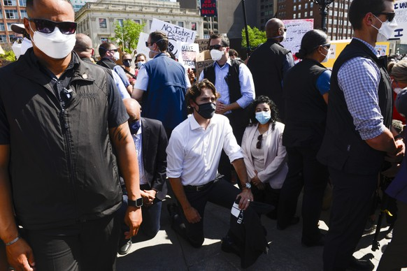 Prime Minister Justin Trudeau takes a knee as he takes part in an anti-racism protest on Parliament Hill during the COVID-19 pandemic in Ottawa, Friday, June 5, 2020. The death of George Floyd, a black man who died after he was restrained by Minneapolis police officers on May 25 has ignited protests in the U.S. and worldwide over racial injustice and police brutality. (Sean Kilpatrick/The Canadian Press via AP) Justin Trudeau