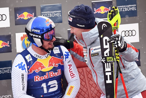 epa07317962 Dominik Paris (L) of Italy and Beat Feuz (R) of Switzerland react in the finish area during the Men's Downhill race of the FIS Alpine Skiing World Cup in Kitzbuehel, Austria, 25 January 2019.  EPA/CHRISTIAN BRUNA