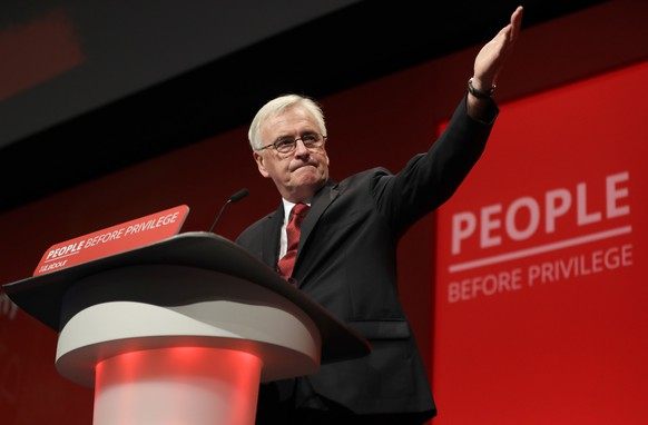 Britain's main opposition Labour Party Shadow Chancellor John McDonnell delivers a speech on stage during the Labour Party Conference at the Brighton Centre in Brighton, England, Monday, Sept. 23, 2019. (AP Photo/Kirsty Wigglesworth)
