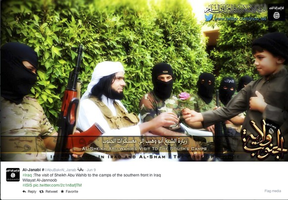 "This Screen grab from an Islamic State group affiliated Twitter account, taken Sunday, Sept. 20, 2014, purports to show senior military commander Abu Wahib handing a flower to a child while visiting southern Iraq, as part of the group's broad social media campaign. As the Islamic State group battles across Syria and Iraq, pushing back larger armies and ruling over entire cities, it is also waging an increasingly sophisticated media campaign that has rallied disenfranchised youth and outpaced the sluggish efforts of Arab governments to stem its appeal. The U.S. State Department launched a ""Think Again Turn Away"" campaign on YouTube, Facebook and Twitter, with Arabic and English videos similar in style to those of al-Qaida and the Islamic State group but none have gained the traction of the Islamic State's videos. (AP Photo, via Twitter)"