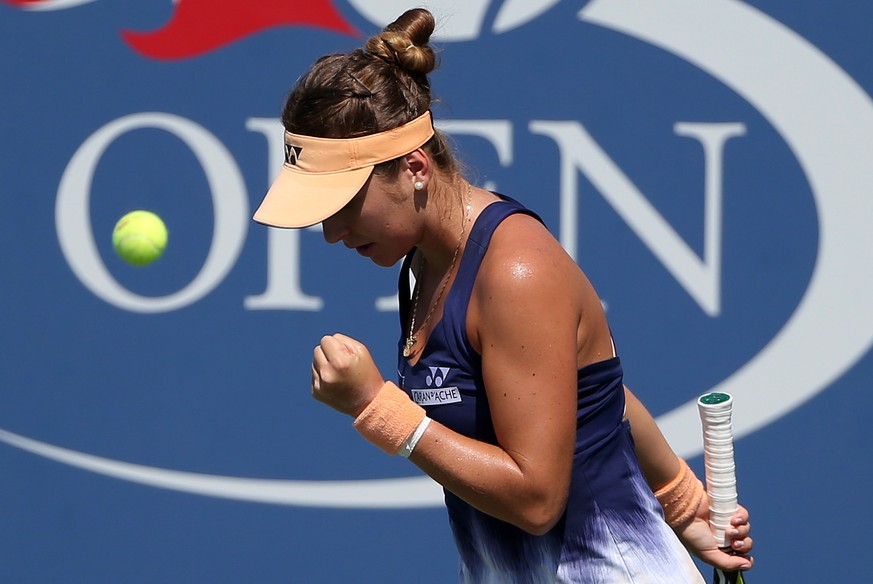 Belinda Bencic, of Switzerland, reacts after a shot to Samantha Crawford, of the United States, during the first round of the U.S. Open tennis tournament, Monday, Aug. 29, 2016, in New York. (AP Photo/Seth Wenig)