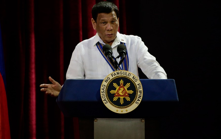 epa07243454 Philippine President Rodrigo Duterte gestures as he delivers a speech at the Philippine Air Force's change of command ceremony at the Villamor Airbase in Manila, Philippines, 21 December 2018.  Lt. Gen. Rozzano Briguez replaced outgoing Lt. Gen. Galileo Gerard Kintanar Jr. as the new chief of the Philippine Air Force.  EPA/MARK R. CRISTINO