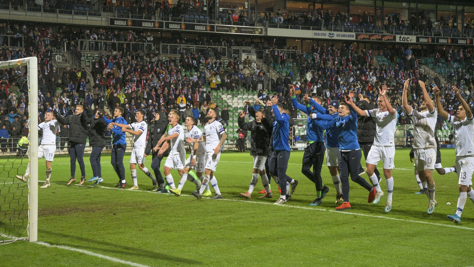 epa07923471 Finnish team celebrates with supporters after the UEFA EURO 2020 qualifiers match between Finland and Armenia at the Veritas Stadium in Turku, Finland, 15 October 2019.  EPA/VESA-MATTI VAARA