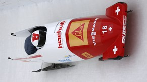 Switzerland's pilot Rico Peter and brakeman Janne Bro van der Zijde train for the two-man bobsled World Cup event on Thursday, Dec. 11, 2014, in Lake Placid, N.Y. Competition begins on Friday. (AP Photo/Mike Groll)