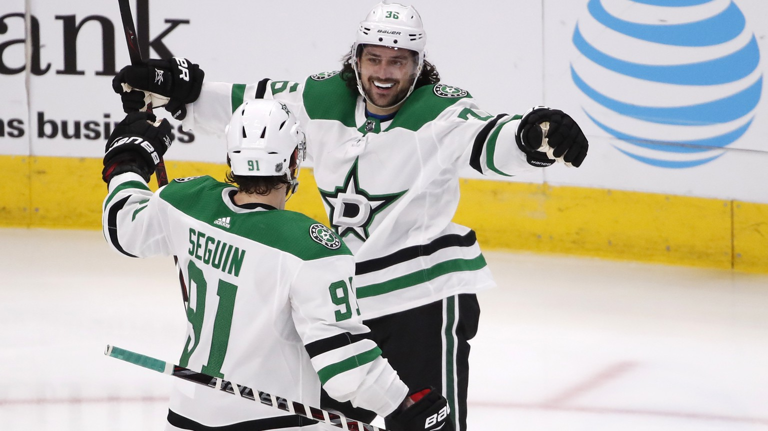 Dallas Stars' Mats Zuccarello celebrates with teammate Tyler Seguin (91) after his goal during the second period of an NHL hockey game against the Chicago Blackhawks Sunday, Feb. 24, 2019, in Chicago. (AP Photo/Jeff Haynes)