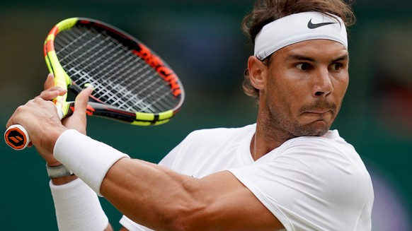 epa07699331 Rafael Nadal of Spain in action against Jo-Wilfried Tsonga of France during their third round match at the Wimbledon Championships at the All England Lawn Tennis Club, in London, Britain, 06 July 2019. EPA/WILL OLIVER EDITORIAL USE ONLY/NO COMMERCIAL SALES