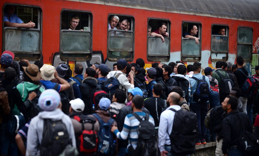 epa04807102 Migrants wait for a train to Serbia at a train station in Demi Kapija, Former Yugoslav Republic of Macedonia 18 June 2015. Migrants from Syria, Pakistan and Afghanistan have begun the favour the land route through Turkey, Greece, FYROM, Serbia and Hungary on their way to European Union countries as the EU mulls plans to stem passage across the Mediterranean. According to local reports Hungary announced plans 17 June to build a four meter high fence along its border with Serbia to stem the flow of illegal migrants.  EPA/NAKE BATEV  EPA/NAKE BATEV