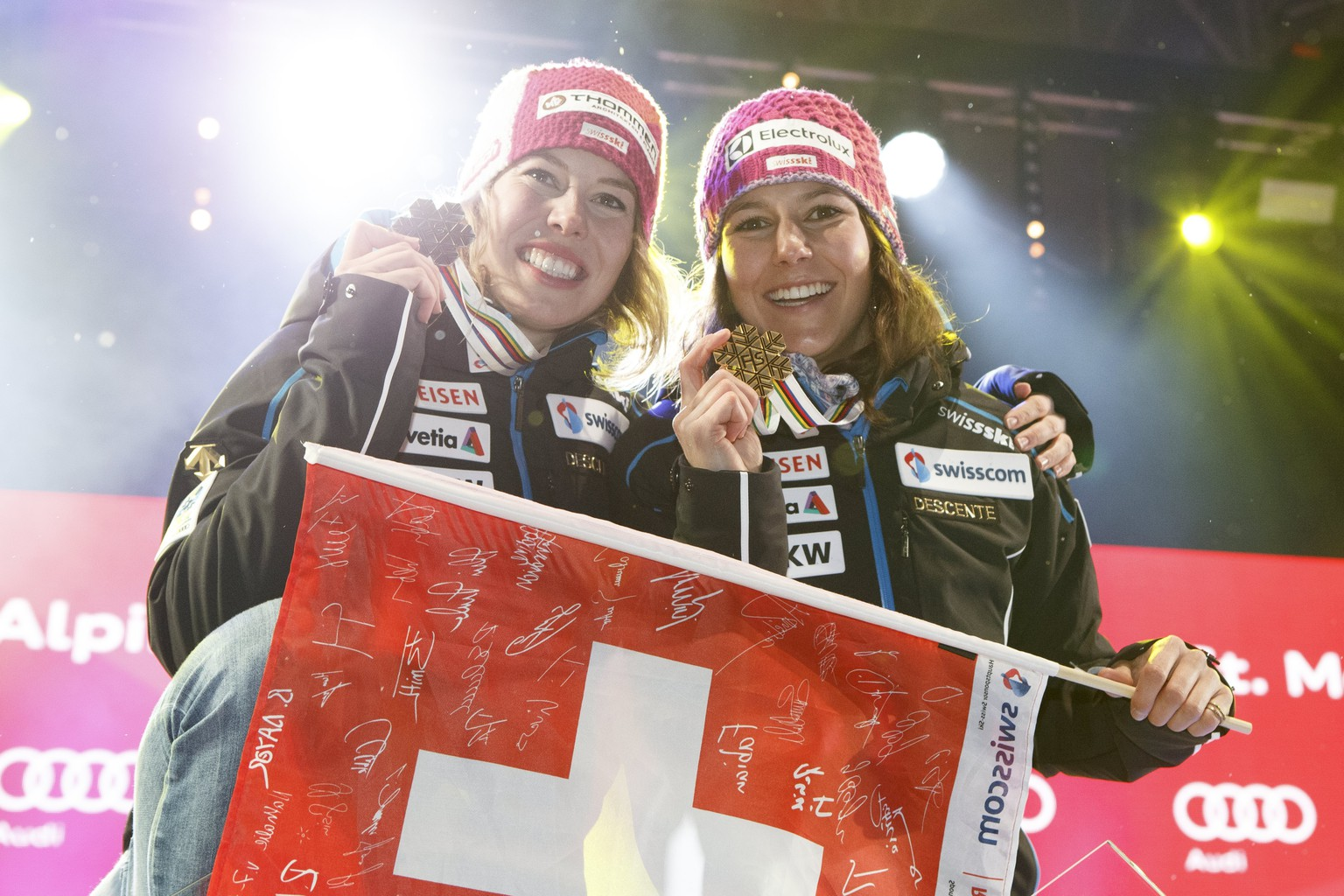 epa05783572 Silver medalist Michelle Gisin (L) and Gold medalist Wendy Holdener of Switzerland, celebrate during the Women's Combined competition winner's presentation at the 2017 FIS Alpine Skiing World Championships in St. Moritz, Switzerland, 10 February 2017.  EPA/ALEXANDRA WEY