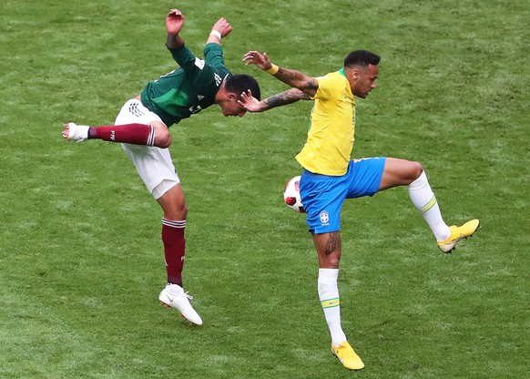 epa06858008 Neymar (R) of Brazil in action against Edson Alvarez (L) of Mexico during the FIFA World Cup 2018 round of 16 soccer match between Brazil and Mexico in Samara, Russia, 02 July 2018.  (RESTRICTIONS APPLY: Editorial Use Only, not used in association with any commercial entity - Images must not be used in any form of alert service or push service of any kind including via mobile alert services, downloads to mobile devices or MMS messaging - Images must appear as still images and must not emulate match action video footage - No alteration is made to, and no text or image is superimposed over, any published image which: (a) intentionally obscures or removes a sponsor identification image; or (b) adds or overlays the commercial identification of any third party which is not officially associated with the FIFA World Cup)  EPA/TATYANA ZENKOVICH   EDITORIAL USE ONLY