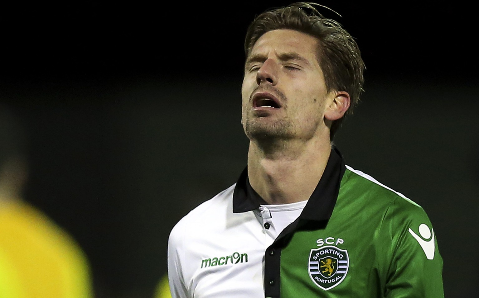 epa05725741 Sporting Adrien Silva reacts after losing their Portuguese Cup soccer match held at Chaves Municipal stadium, Chaves, Portugal, 17 January 2017.  EPA/JOSE COELHO