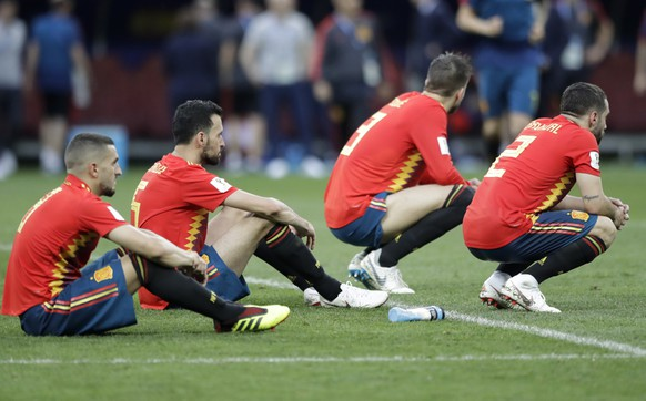 Spanish players react after there team was eliminated during the round of 16 match between Spain and Russia at the 2018 soccer World Cup at the Luzhniki Stadium in Moscow, Russia, Sunday, July 1, 2018. (AP Photo/Matthias Schrader)