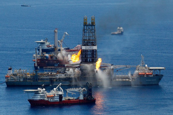 FILE - SEPTEMBER 2, 2014: It was reported that Halliburton has reached a $1.1 billion settlement for a majority of claims against the company for its role in the BP oil spill in the Gulf of Mexico in 2010 September 2, 2014. GULF OF MEXICO - JUNE 25:  The Transocean Discoverer Enterprise drillship burns off gas collected at the BP Deepwater Horizon oil spill in the Gulf of Mexico off the coast of Louisiana on June 25, 2010. An approaching tropical disturbance may force collecting operations involving ships and other siphoning equipment to be temporarily halted.  This may cause oil to flow unchecked from the well until the weather improves and siphoning operations can be restored.   (Photo by Chris Graythen/Getty Images)