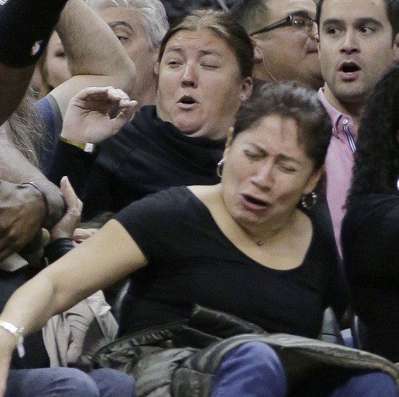 Los Angeles Clippers' DeAndre Jordan falls into a row of fans during the first half of an NBA basketball game against the San Antonio Spurs, Saturday, Jan. 31, 2015, in San Antonio. (AP Photo/Eric Gay)
