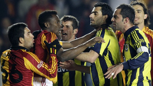 FILE- In this April 12, 2009 file photo, the players of Istanbul's two major teams Galatasaray and Fenerbahce fight each other in the final minute of their tense Turkey Super League derby match that ended in a 0-0 draw at the Ali Sami Yen stadium in Istanbul, Turkey. (AP Photo/Ibrahim Usta, File)