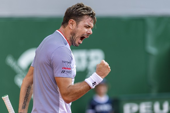 "Stanislas ""Stan"" Wawrinka, of Switzerland, reacts after winning a point to Damir Dzumhur, of Bosnia and Herzegovina, during their second round match, at the ATP 250 Geneva Open tournament in Geneva, Switzerland, Wednesday, May 22, 2019. (KEYSTONE/Martial Trezzini)"
