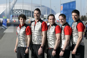 Members of the Swiss men's Curling team, from left, Benoit Schwarz, Sandro Trolliet, skip Sven Michel, Simon Gempeler and Claudio Paetz pose for photographers in front of the Bolshoi stadium during a press conference of the Swiss men's curling team at the XXII Winter Olympics 2014 Sochi at the House of Switzerland in Sochi, Russia, on Friday, February 7, 2014. (KEYSTONE/Laurent Gillieron)