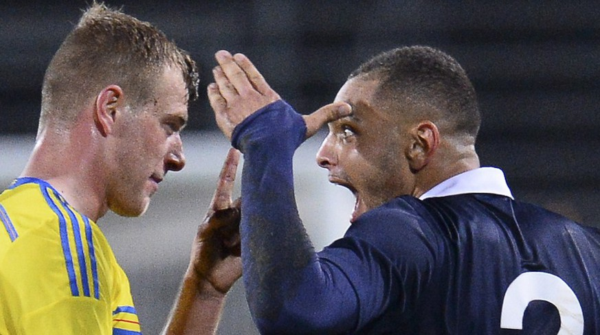 France's defender Layvin Kurzawa celebrates next to Sweden's forward John Guidetti (C) after scoring a goal during the UEFA U21 European Championships qualifying football match between Sweden and France on October 14, 2014 at the Orjans Vall Stadium, in  Halmstad, southern Sweden. AFP PHOTO / JONATHAN NACKSTRAND