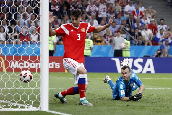 epa06872398 Goalkeeper Igor Akinfeev of Russia (R) looks on as a shot of Ivan Perisic of Croatia (unseen) hits the post during the FIFA World Cup 2018 quarter final soccer match between Russia and Croatia in Sochi, Russia, 07 July 2018.  (RESTRICTIONS APPLY: Editorial Use Only, not used in association with any commercial entity - Images must not be used in any form of alert service or push service of any kind including via mobile alert services, downloads to mobile devices or MMS messaging - Images must appear as still images and must not emulate match action video footage - No alteration is made to, and no text or image is superimposed over, any published image which: (a) intentionally obscures or removes a sponsor identification image; or (b) adds or overlays the commercial identification of any third party which is not officially associated with the FIFA World Cup)  EPA/SHAWN THEW   EDITORIAL USE ONLY