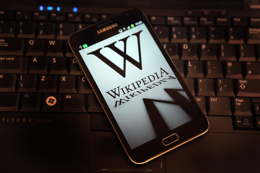 LONDON, ENGLAND - JANUARY 18:  A mobile device shows Wikipedia's front page displaying a darkened logo on January 18, 2012 in London, England. The Wikipedia website has shut down it's English language service for 24 hours in protest over the US anti-piracy laws.  (Photo by Peter Macdiarmid/Getty Images)