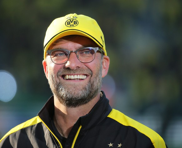 epa04776158 Dortmund's coach  Juergen Klopp smiles prior to the DFB Cup final soccer match  Borussia Dortmund vs VfL Wolfsburg  in Berlin, Germany, 30 May 2015.  (EMBARGOCONDITIONS- ATTENTION: The DFB prohibits the utilisation and publication of sequential pictures on the internet and other online media during the match (including half-time). ATTENTION: BLOCKING PERIOD! The DFB permits the further utilisation and publication of the pictures for mobile services (especially MMS) and for DVB-H and DMB only after the end of the match.)  EPA/KAYNIETFELD