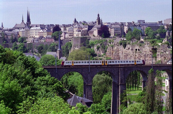 Luxemburg's old town skyline is seen from across the deep gorge that runs through the city in July, 1996. The Grand Duchy of Luxembourg is a land where almost everybody has a job, the budget is balanced and incomes are among the world's highest. Small wonder the national motto is ``We want to stay what we are!''  (AP Photo/Paul Ames)