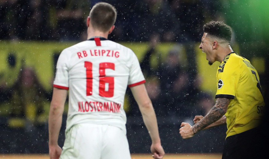 epa08078262 Dortmund's Jadon Sancho (R) celebrates scoring during the German Bundesliga soccer match between Borussia Dortmund and RB Leipzig in Dortmund, Germany, 17 December 2019.  EPA/FRIEDEMANN VOGEL CONDITIONS - ATTENTION: The DFL regulations prohibit any use of photographs as image sequences and/or quasi-video.