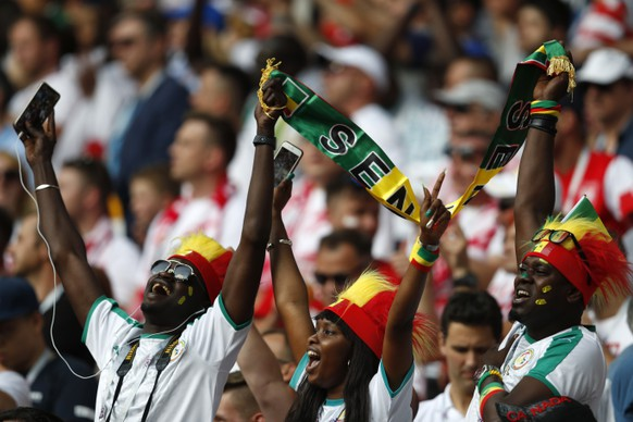 Senegal soccer fans sing their national anthem prior to the start of the group H match between Poland and Senegal at the 2018 soccer World Cup in the Spartak Stadium in Moscow, Russia, Tuesday, June 19, 2018. (AP Photo/Eduardo Verdugo)