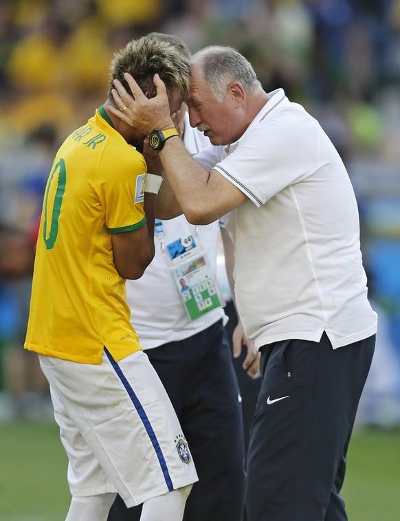 Brazil's coach Luiz Felipe Scolari embraces Brazil's Neymar after the World Cup round of 16 soccer match between Brazil and Chile at the Mineirao Stadium in Belo Horizonte, Brazil, Saturday, June 28, 2014. Brazil won 3-2 on penalties. (AP Photo/Frank Augstein)