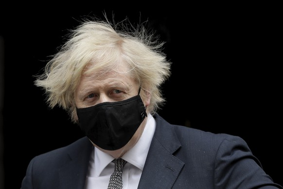 Wearing a number 10 logo face mask to curb the spread of coronavirus British Prime Minister Boris Johnson leaves 10 Downing Street in London, to attend the weekly Prime Minister's Questions at the Houses of Parliament, in London, Wednesday, March 24, 2021. (AP Photo/Matt Dunham)