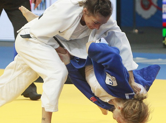 Majlinda Kelmendi from Kosovo fights against Alesya Kuznetsova of Russia in the women's under 57kg competition during the European Judo Championships in Warsaw, Poland, Thursday, April 20, 2017. (AP Photo/Czarek Sokolowski)