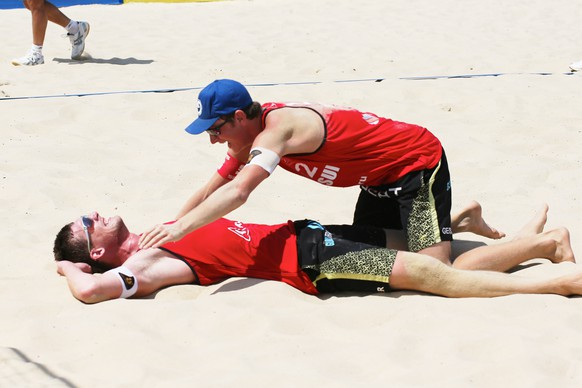 ANAPA, RUSSIA - JUNE 1: Philip Gabathuler (left) and Mirco Gerson from  Switzerland celebrate winning in the match against the Chevallier-Strasser SUI team during day 6 of the FIVB Anapa Open on June 1, 2014 in Anapa, Russia. (Photo by Oleg Nikishin/Getty Images for FIVB)