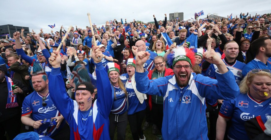 epa05395231 Iceland supporters celebrate a goal for their team during a public viewing in Reykjavik, Iceland, 27 June 2016, as they watch the UEFA EURO 2016 round of 16 match between England and Iceland.  EPA/EYTHOR ARNASON ICELAND OUT