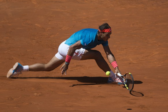 Rafael Nadal of Spain returns a shot to Simone Bolelli of Italy during the Madrid Open Tennis tournament in Madrid, Spain, Thursday, May 7, 2015. Nadal won the match 6-2, 6-2. (AP Photo/Paul White)