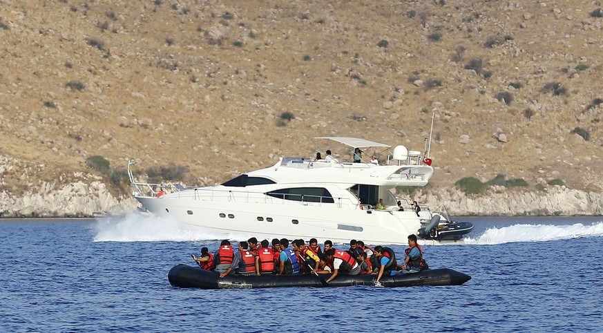 More than 20 migrants onboard a dinghy with a broken motor and two shovels try to return back to Turkey as they drift while attempting to reach the Greek Island of Kos after leaving Bodrum, Turkey, September 20, 2015. Many refugees attempt to use Turkey as a springboard into wealthier Europe. REUTERS/Umit Bektas
