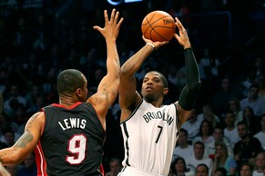 May 10, 2014; Brooklyn, NY, USA; Brooklyn Nets guard Joe Johnson (7) shoots over Miami Heat forward Rashard Lewis (9) during the third quarter in game three of the second round of the 2014 NBA Playoffs at Barclays Center. Brooklyn Nets won 104-90.  Mandatory Credit: Anthony Gruppuso-USA TODAY Sports