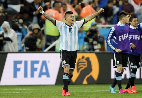 Argentina's Marcos Rojo celebrates after the World Cup semifinal soccer match between the Netherlands and Argentina at the Itaquerao Stadium in Sao Paulo, Brazil, Wednesday, July 9, 2014. Argentina beat the Netherlands 4-2 in a penalty shootout to reach the World Cup final. (AP Photo/Frank Augstein)