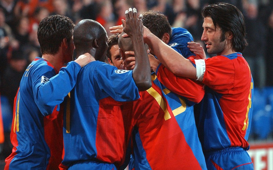Basel's players congratulate Christian Gimenez, Nr. 13, after he scored the second goal for Basel, Tuesday, March 18, 2003, during the Champions League soccer match between FC Basel and Juventus Football Club Turin in the St. Jakobspark in Basel, Switzerland. Basel won 2-1. (KEYSTONE/Markus Stuecklin)
