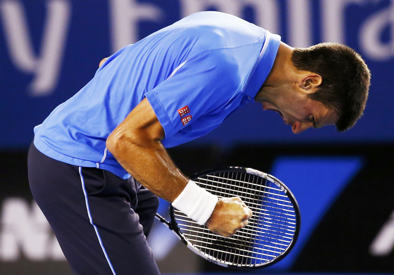 Novak Djokovic of Serbia reacts after winning a point against Stan Wawrinka of Switzerland during their men's singles semi-final match at the Australian Open 2015 tennis tournament in Melbourne January 30, 2015. REUTERS/Issei Kato (AUSTRALIA  - Tags: SPORT TENNIS TPX IMAGES OF THE DAY)