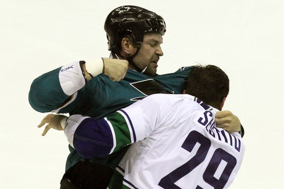 Sep 23, 2014; Stockton, CA, USA; San Jose Sharks John Scott (20) fights with Vancouver Canucks Tom Sestito (29) in a first period fight during their  NHL Preseason game at the Stockton Arena. Mandatory Credit: Lance Iversen-USA TODAY Sports