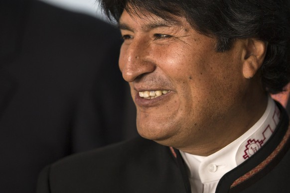 "FILE- In this July 16, 2014, file photo, Bolivia's President Evo Morales poses for a photo during the BRICS Summit at the Itamaraty Palace, in Brasilia, Brazil. The Bolivian leader is running for re-election and he urged followers on Sunday to spread the word about his policies so that Bolivian couples can decide who to vote for before drifting off to sleep. In his words, ""The couple decides its vote in bed."" (AP Photo/Felipe Dana,File)"