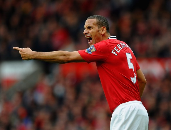 FILE - JULY 17, 2014: Former Manchester United defender Rio Ferdinand signs for Queens Park Rangers on July 17, 2014. MANCHESTER, ENGLAND - OCTOBER 23:  Rio Ferdinand of Manchester United in action during the Barclays Premier League match between Manchester United and Manchester City at Old Trafford on October 23, 2011 in Manchester, England.  (Photo by Laurence Griffiths/Getty Images)