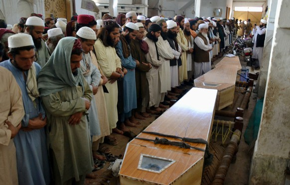 epa08778391 Relatives and people attend the funeral ceremony of victims who were killed in blast at an Islamic seminary in Peshawar, Pakistan, 27 October 2020. At least seven people died, including children, and more than 70 were injured in an explosion at a seminary in Peshawar. No group has yet claimed responsibility.  EPA/ARSHAD ARBAB