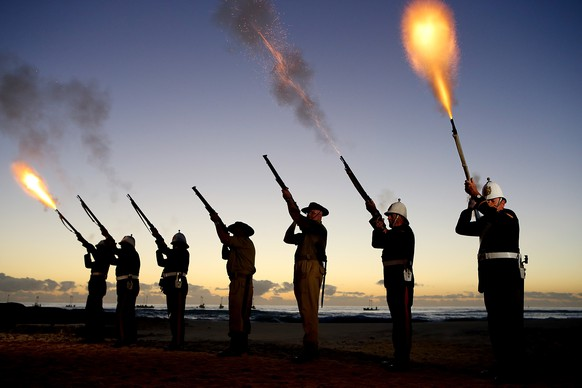 GOLD COAST, AUSTRALIA - APRIL 25: Members of the Albert Battery shoot a volley of fire during the ANZAC dawn service at Currumbin Surf Life Saving Club on April 25, 2014 in Gold Coast, Australia. Veterans, dignitaries and members of the public today marked the 99th anniversary of ANZAC (Australia New Zealand Army Corps) Day, April 25, 1915 when allied First World War forces landed on the Gallipoli Peninsula. A public holiday in both Australia and New Zealand, commemoration events are held across both countries in remembrance of those who fought and died in all wars.  (Photo by Chris Hyde/Getty Images)