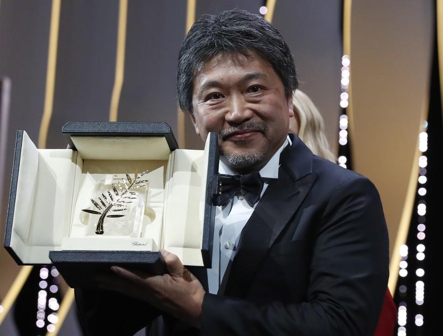 epa06750842 Hirozaku Kore-Eda accepts the Palm d'Or (Golden Palm) for the movie 'Shoplifters (Manbiki Kazoku)' during the Closing Awards Ceremony of the 71st Cannes Film Festival, in Cannes, France, 19 may 2018.  EPA/IAN LANGSDON